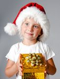 Girl with gifts in santa hat Royalty Free Stock Photo