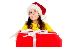 Girl with gifts in santa hat Stock Image