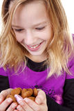 Girl with ginger nuts (pepernoten) Royalty Free Stock Image