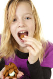 Girl with ginger nuts (pepernoten) Royalty Free Stock Images