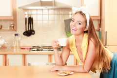 Girl with gingerbread cookies drinking tea coffee. Royalty Free Stock Images