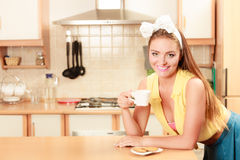 Girl with gingerbread cookies drinking tea coffee. Stock Images