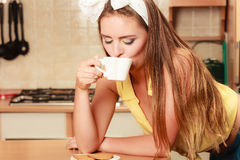 Girl with gingerbread cookies drinking tea coffee. Stock Image