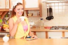 Girl with gingerbread cookies drinking tea coffee. Stock Photo