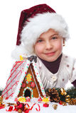 Girl with gingerbread house Royalty Free Stock Image