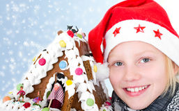 Girl with gingerbread house Royalty Free Stock Photos