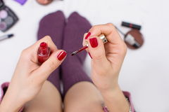 Girl girl nail polishing in bed Royalty Free Stock Images