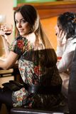 Girl with girlfriend with wineglasses Stock Photo