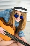 Girl with gitar Stock Image