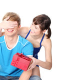 Girl give a gift to her boyfriend. Isolated on white background Royalty Free Stock Image