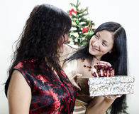 Girl gives another girl a gift Stock Images