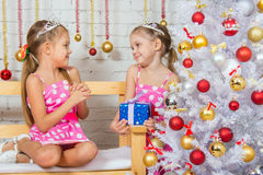 Girl gives another girl New Years gift Royalty Free Stock Photos