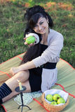 Girl gives an apple Stock Photo