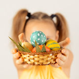 Girl gives basket with Easter eggs Royalty Free Stock Photo