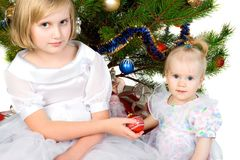Girl gives christmas ball Royalty Free Stock Photos
