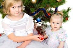 Girl gives christmas ball Royalty Free Stock Photos