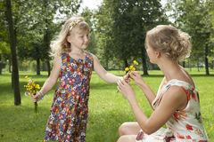 Girl gives a flowers mother Stock Photography