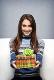 Girl gives a gift Stock Photo
