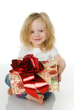 The girl gives a gift Royalty Free Stock Image