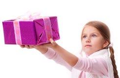 Girl gives a gift box Stock Photos