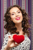 Girl gives heart. Concept of Valentine's Day Royalty Free Stock Image