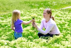 Girl gives mum a bouquet of flowers Royalty Free Stock Photo