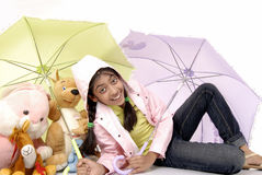 Girl gives protection to toy Stock Images