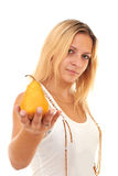 Girl gives a ripe pear Royalty Free Stock Image