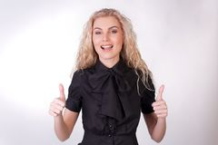 Girl gives a thumbs up Royalty Free Stock Photo