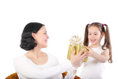 Girl gives to mum a gift. Royalty Free Stock Photos
