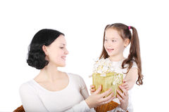 Girl gives to mum a gift. Royalty Free Stock Images