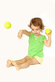 A girl gives up a ball. Royalty Free Stock Image