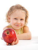 Girl giving an apple Stock Photos