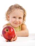 Girl giving an apple Stock Photos