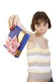 A girl giving back a present Royalty Free Stock Photos