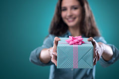 Girl giving a beautiful gift stock images
