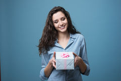 Girl giving a beautiful gift Stock Photography