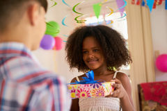 Girl Giving Birthday Present To Boy Classmate Royalty Free Stock Images