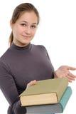 Girl, giving the book Stock Photos