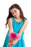 Girl giving flowers Royalty Free Stock Images