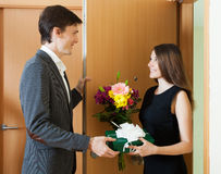 Girl giving flowers and gift Royalty Free Stock Photos