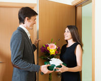 Girl giving flowers Stock Photo