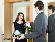 Girl giving flowers and present Royalty Free Stock Photo