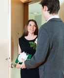 Girl giving flowers to a man royalty free stock photos