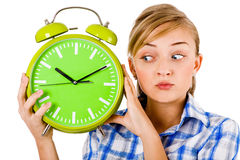 Girl Giving Funny Expression And Holding The Alarm Royalty Free Stock Photography