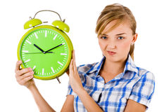 Girl giving funny expression and holding the alarm Stock Photo