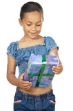 Girl giving a gift Stock Photos