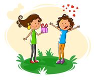 Girl giving gift to boy for Valentine's Day Royalty Free Stock Photos