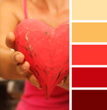 Girl giving hands heart.  color palette swatches.. pastel hues Royalty Free Stock Photo