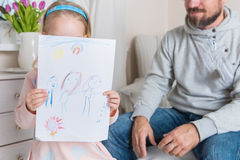 Girl giving her father a drawing, fathers day concept Stock Image